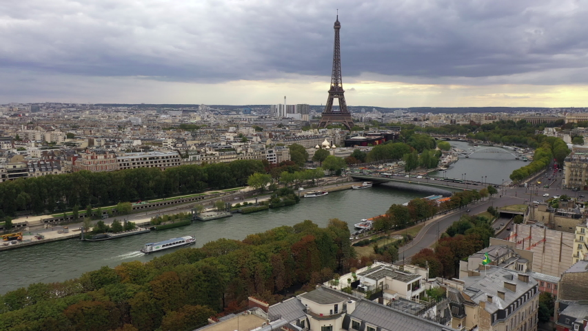 Paris with Eiffel tower with Seine river during sunset | Shutterstock HD Video #1040979551