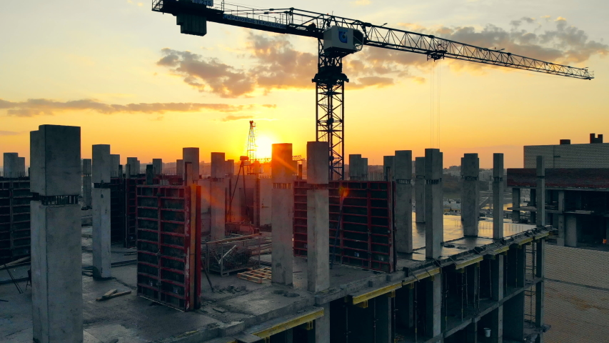 High crane works on building site with a house. | Shutterstock HD Video #1040984291