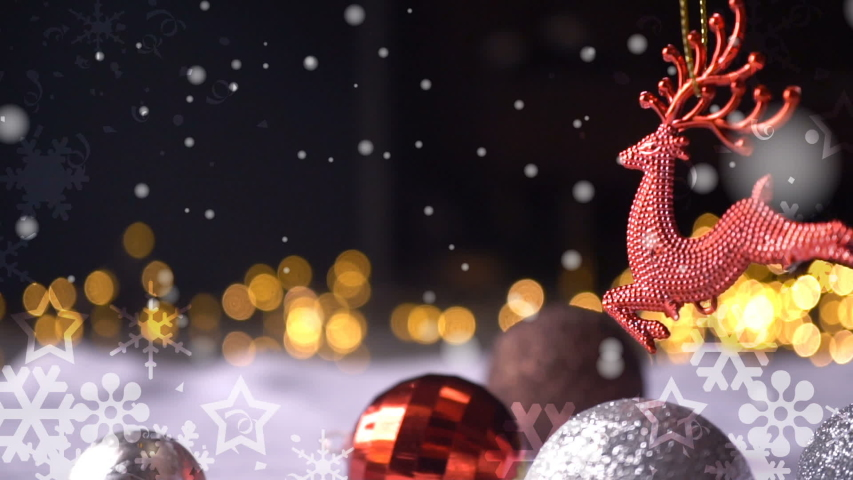 Red reindeer Christmas Decoration and snow falling and bokeh light for new year , celebration , seasonal holidays concept background | Shutterstock HD Video #1041019271