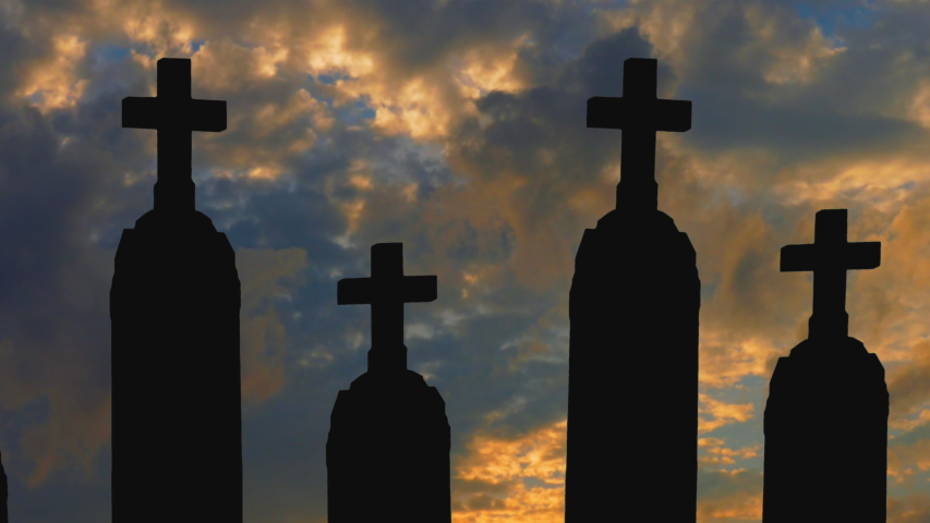 Classic Christian gravestones silhouetted against dramatic sky with fast moving clouds.  | Shutterstock HD Video #1041053831