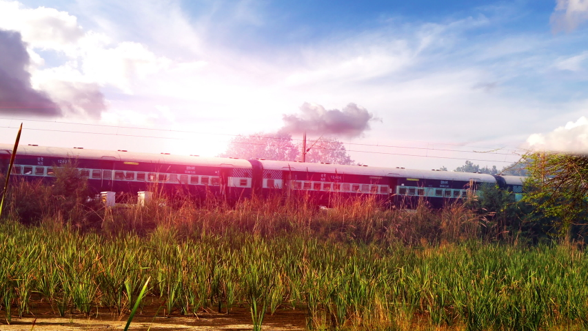 Express train moving forward during springtime under the beautiful cloudscape. | Shutterstock HD Video #1041098161
