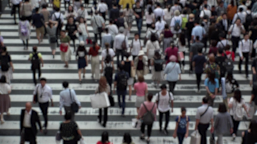 UMEDA, OSAKA, JAPAN - CIRCA SEPTEMBER 2019 : Aerial blurred high angle view of zebra crossing near Osaka train station. Crowd of people at the street. Shot in busy rush hour. | Shutterstock HD Video #1041099151