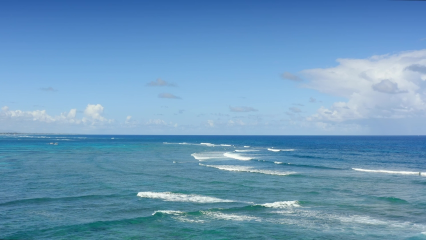 Sea and Sky 4K. White waves on blue sea landscape. Beautiful white clouds in blue sky. Nature seascape. Azure Caribbean sea water and sky background.  | Shutterstock HD Video #1041156481
