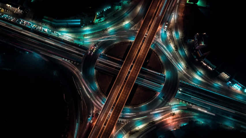 Aerial view of Modern transportation with Expressway, Road and Roundabout, multilevel junction highway-Top view. Car movement at night Important infrastructure in Bangkok Thailand. | Shutterstock HD Video #1041252391