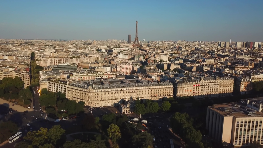 Aerial top view of old historical cityscape and the Eiffel Tower. Taken by drone at early morning | Shutterstock HD Video #1041392731