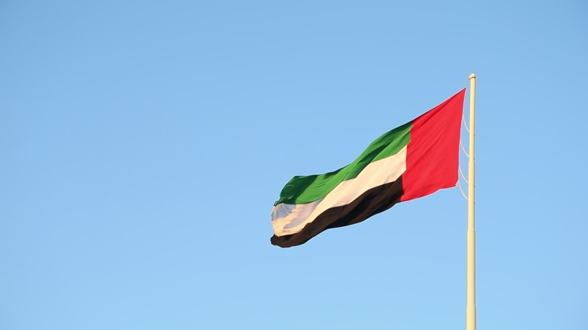 UAE flag waving in the sky, national symbol of UAE. UAE National Day. UAE flag day. | Shutterstock HD Video #1041485701
