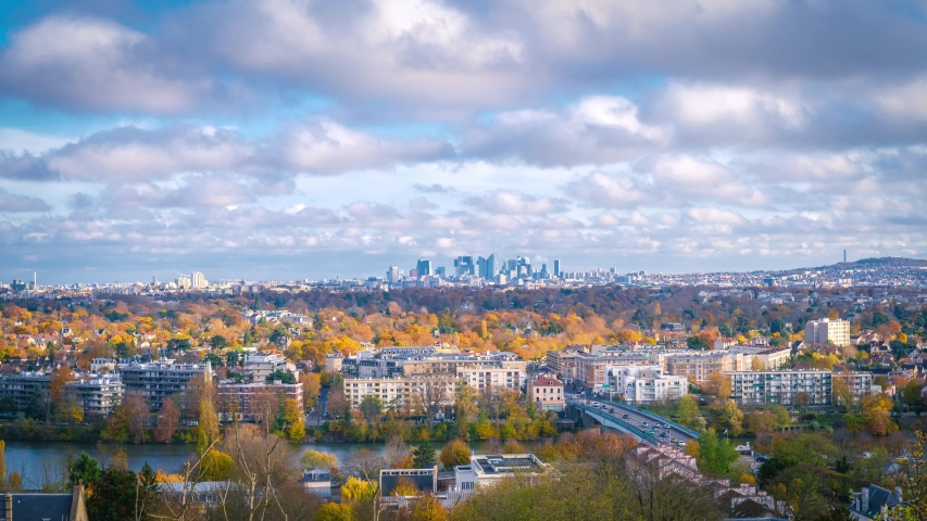 Timelapse on countryside from Saint-Germain-en-Laye, west of Paris, France. Timelapse at a sunny autumn day with blue cloudy sky. skyscrapers of Business district La Defense in the distince.  | Shutterstock HD Video #1041689761