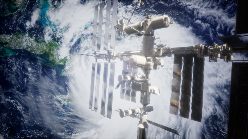 A view of the Earth and a spaceship. International space station is orbiting the Earth, Elements furnished by NASA. | Shutterstock HD Video #1042032181