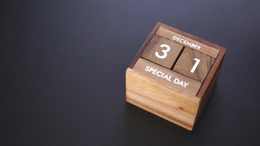 Day and month of special day of year fill into wooden cube calendar, copy space on left | Shutterstock HD Video #1042247941
