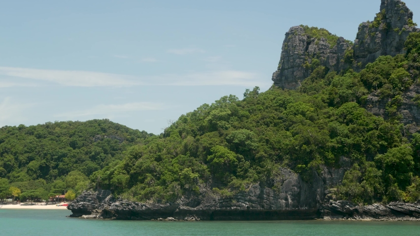 Group of Islands in ocean at Ang Thong National Marine Park near touristic Samui paradise tropical resort. Archipelago in the Gulf of Thailand. Idyllic turquoise sea natural background, copy space | Shutterstock HD Video #1042276981
