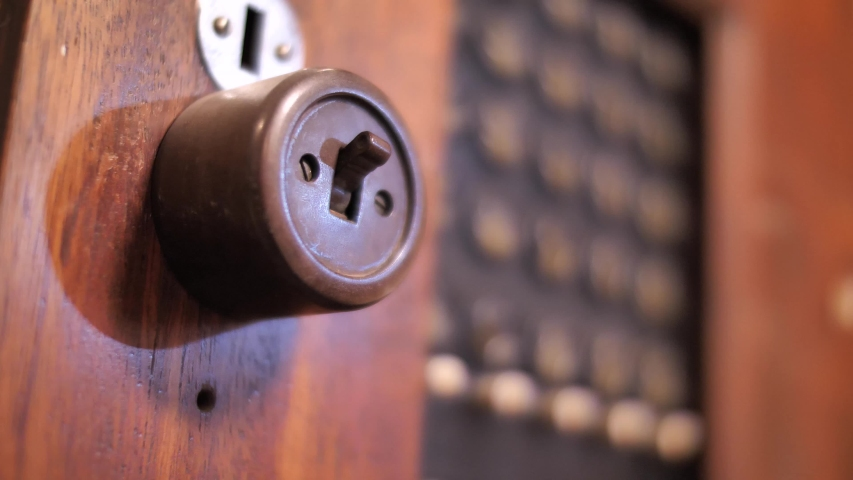 Close up on hand commuting switch on old fashioned wooden telephone exchange | Shutterstock HD Video #1042406851