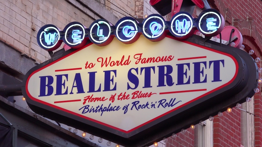 MEMPHIS, TENNESSEE - CIRCA 2010s - Neon sign on Beale Street, Memphis identifies world famous district of nightclubs, bars and clubs.   Shutterstock HD Video #1042500391