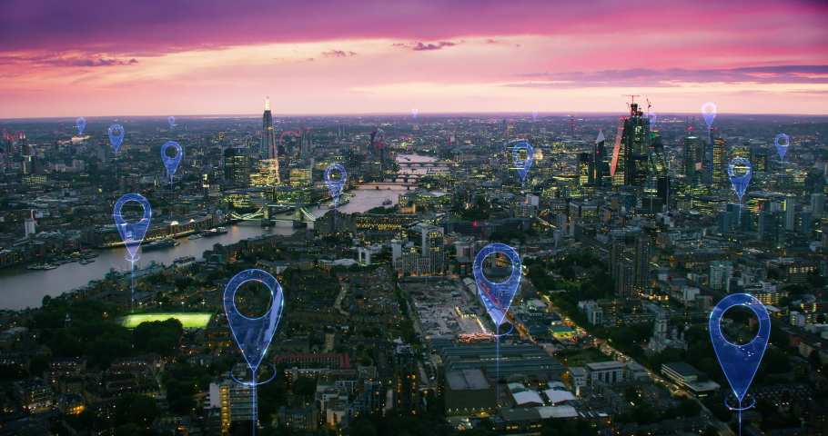 Aerial futuristic view of London skyline. Localization icons in a connected city. Technology concept, data communication, artificial intelligence, internet of things, smart city. Blue icons. England. | Shutterstock HD Video #1042556581