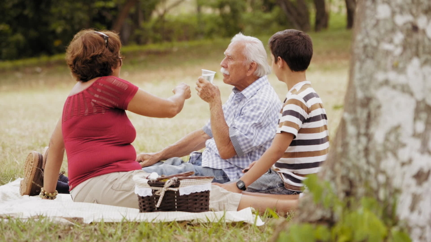Old people, senior couple, elderly man and woman, husband and wife in park, active seniors, retirement age. Sick grandpa taking prescription drugs, medicine, pills for health care, illness, disease  | Shutterstock HD Video #1042616881