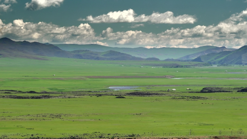 The prairie of Mongolian steppes shortgrass and mixed prairie is an example of a moorland. Central asian Eurasian tableland asia. Mongolia Mongol meadow grassland pasture yurt ger tent vast landscape. | Shutterstock HD Video #1042632151