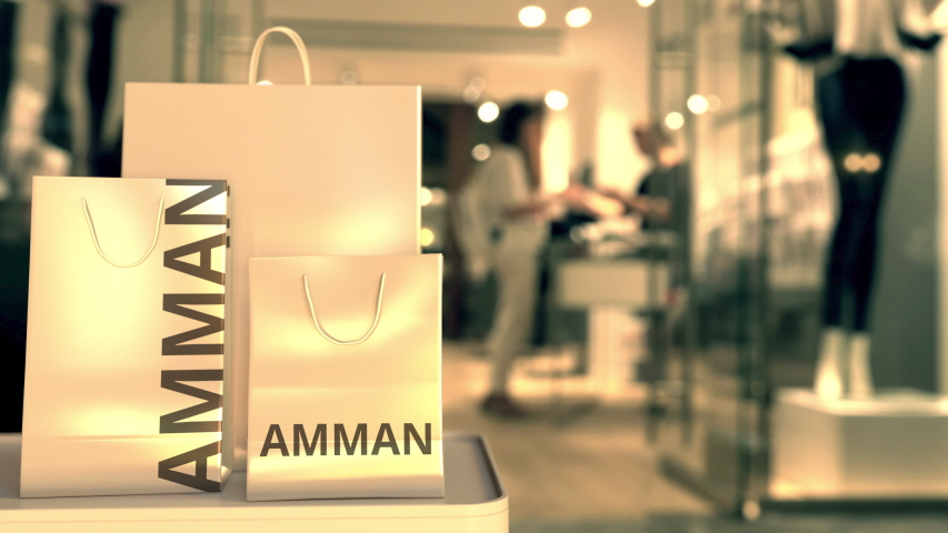 Shopping bags with Amman caption against blurred store entrance. Shopping in Jordan related 3D animation | Shutterstock HD Video #1042643551
