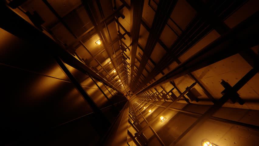 02300 Inside of Elevator Shaft With Moving Elevator.