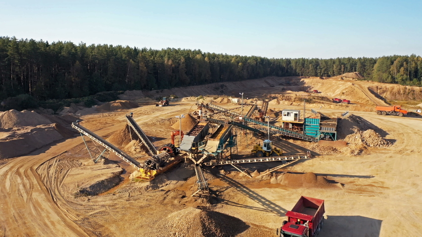 4K. Aerial view of a large Sand Quarry in working process with heavy machinery: sorting conveyor, bulldozers, excavators and trucks.   | Shutterstock HD Video #1042692571