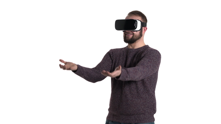 Technology, virtual reality, entertainment and people concept - smiling man with vr headset or 3d glasses playing video game | Shutterstock HD Video #1042778431