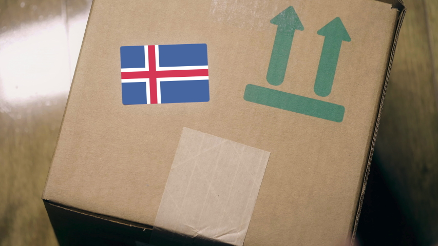 Labeling carton with the Icelandic flag sticker. Import or export in Iceland related clip   Shutterstock HD Video #1042820551