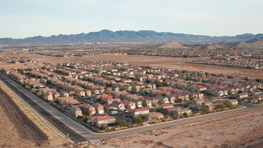 Aerial view of Las Vegas suburban homes with desert mountains, hills landscape | Shutterstock HD Video #1043181721