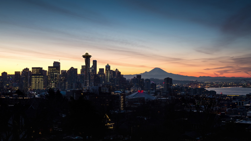 Seattle Skyline Sunrise Timelapse with Space Needle, downtown Seattle, and Mt Rainier in the background Night to Day