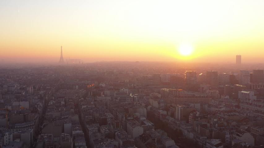 Beautiful sunset over Paris capital France Eiffel Tower rooftops urban pollution | Shutterstock HD Video #1044658501