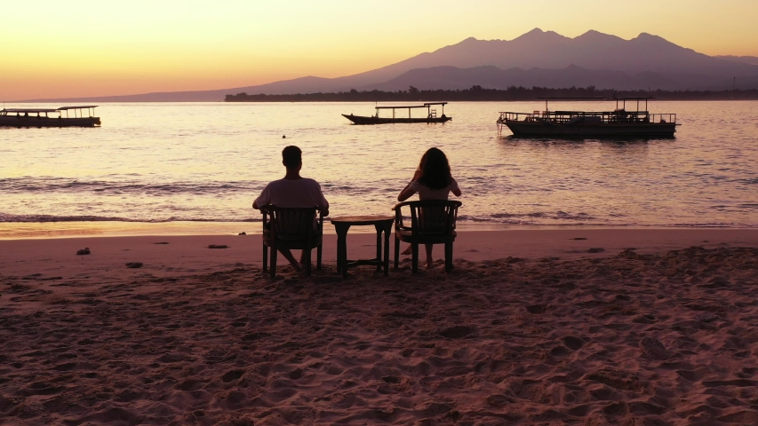 While Sitting Couple Enjoying The Beautiful Sunset In Indonesia - Running Shot | Shutterstock HD Video #1044674701