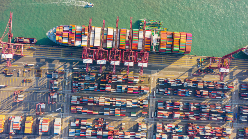 Hyperlapse or Dronelapse Top view of international port with Crane loading containers in import export business logistics.   Shutterstock HD Video #1044848161