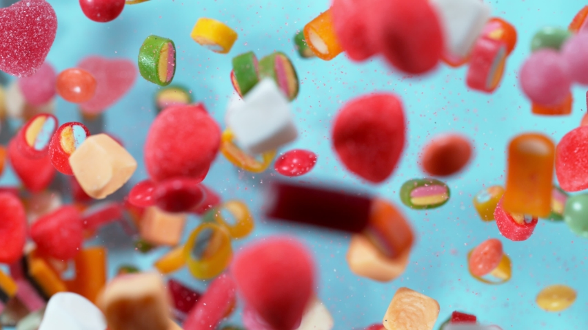 Super slow motion of flying candies up in the air. Filmed on high speed cinema camera, 1000 fps.   Shutterstock HD Video #1044929011