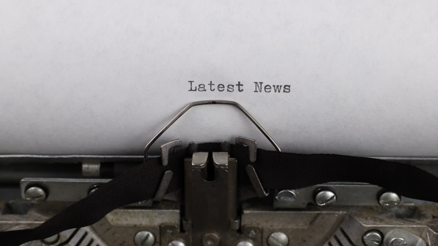 Close-up typing a text latest news, old vintage typewriter with a sheet of paper    Shutterstock HD Video #1044931531