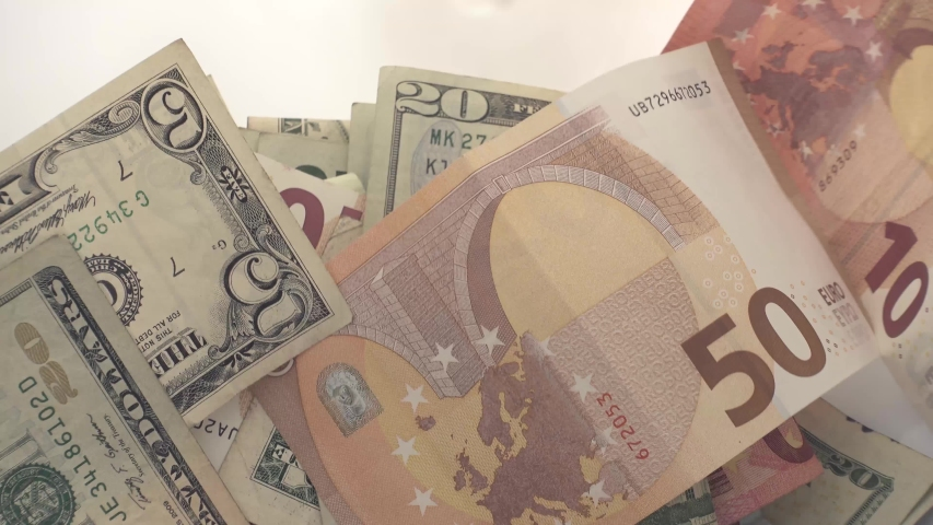 Financial market crisis concept, flying dollar and euro banknotes. | Shutterstock HD Video #1044972361