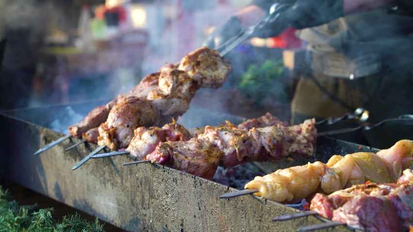 Grilling meat and corn on Christmas holiday market | Shutterstock HD Video #1045026181