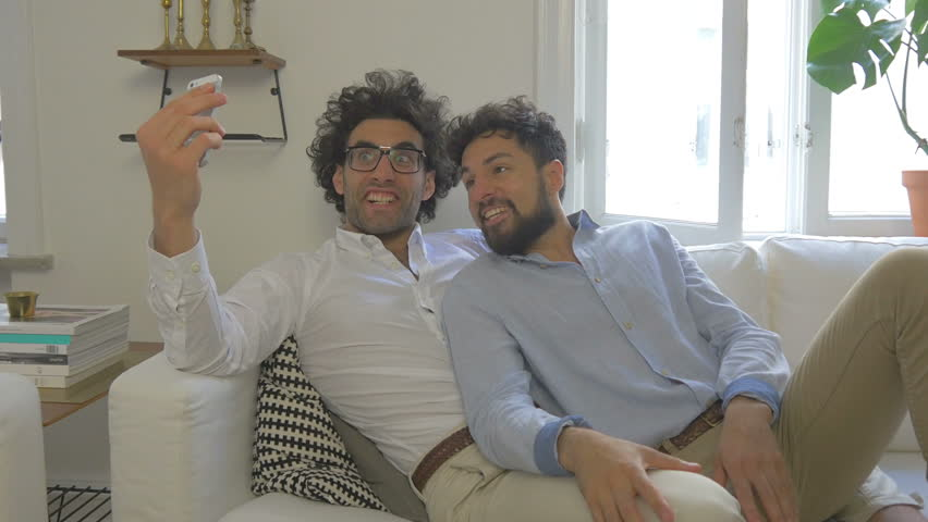 Gay Couple Taking Silly Selfies Together Model Release Supplied Filmed By Noofoo Media