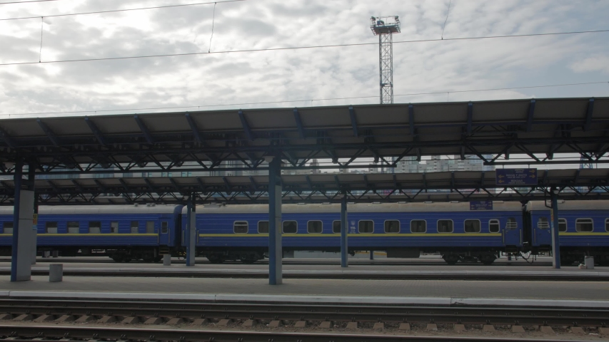 Empty railway platform station with train and clouds sky | Shutterstock HD Video #1045102141