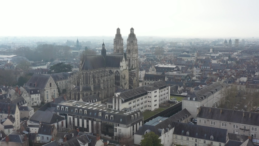 France, Tours city, drone aerial view from back of Saint-Gatien cathedral to its towers. | Shutterstock HD Video #1045192651