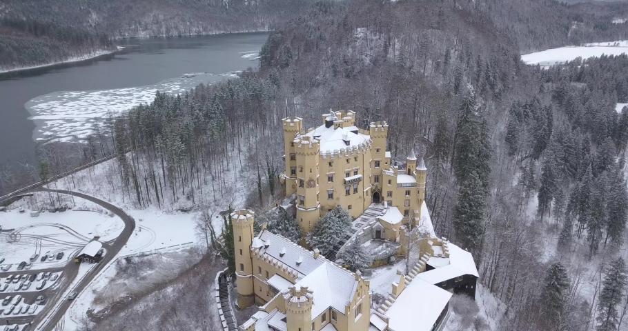 Aerial view of Hohenschwangau Castle 4k winter landscape. Germany | Shutterstock HD Video #1045193401