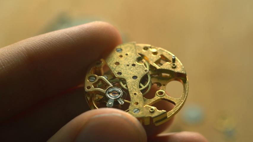 Craftsman installs a gear in mechanical watch | Shutterstock HD Video #1045472011