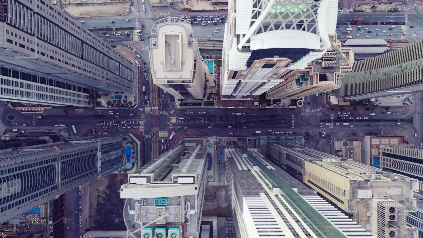 Top view of Dubai city. Aerial Drone fly over futuristic Dubai Marina district on beautiful day. Residential Modern skyscraper buildings | Shutterstock HD Video #1045756051