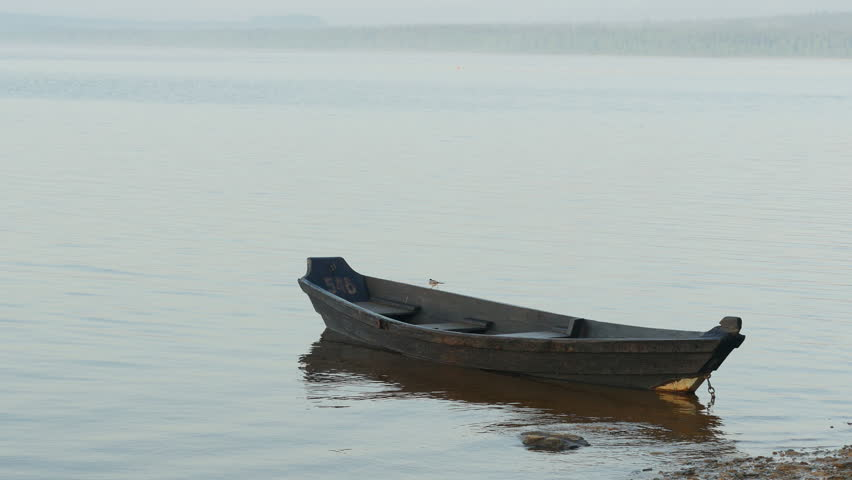 Old Small Wooden Boat On Water 4K UHD Video Fishing Floating