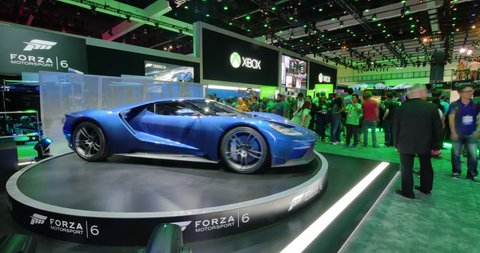 LOS ANGELES - June 16, 2015: Forza Motorsport 6 game booth at E3 2015 expo. Ford and Microsoft have entered into exclusive agreement that will make Ford GT the cover car for the game. Timelapse view.
