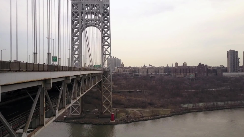 New Jersey /  United States    , Aerial video from  George Washington Bridge , Suspension bridge in Fort Lee ,    taken by drone camera from above | Shutterstock HD Video #1046440471
