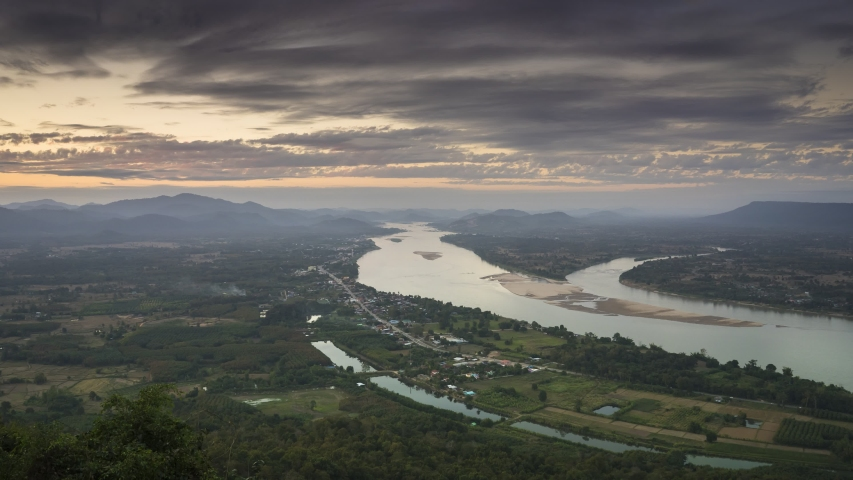 Khong River under cloudy sky acorss mountain separated Thai and Laos country location at north east of thailand | Shutterstock HD Video #1046615281