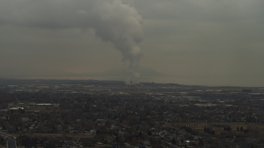 Aerial view of smoke pollution from distant coal power plant / Pleasant Grove, Utah, United States | Shutterstock HD Video #1046778901
