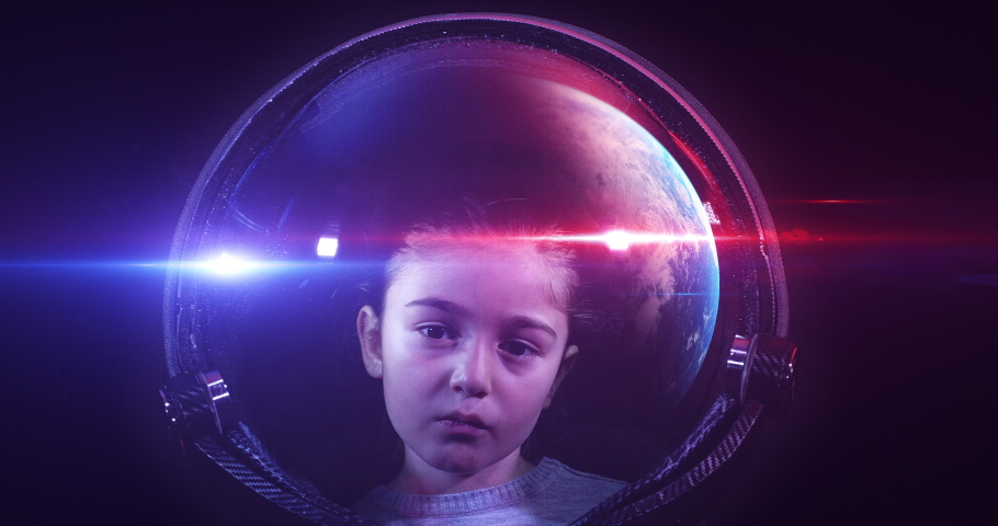 Brave Beautiful Little Girl Astronaut In Space Helmet Looking At Panning Camera. She Is Exploring Outer Space In A Space Suit. Science And Technology Related 4K Concept Footage. | Shutterstock HD Video #1046875591