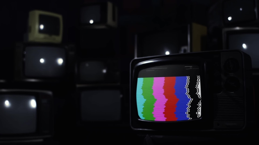 """Old TV Green Screen Over A Retro TV Wall. Dark Blue Tone. Zoom In. You can Replace Green Screen with the Footage or Picture you Want with """"Keying"""" effect in After Effects (check out tutorials). 
