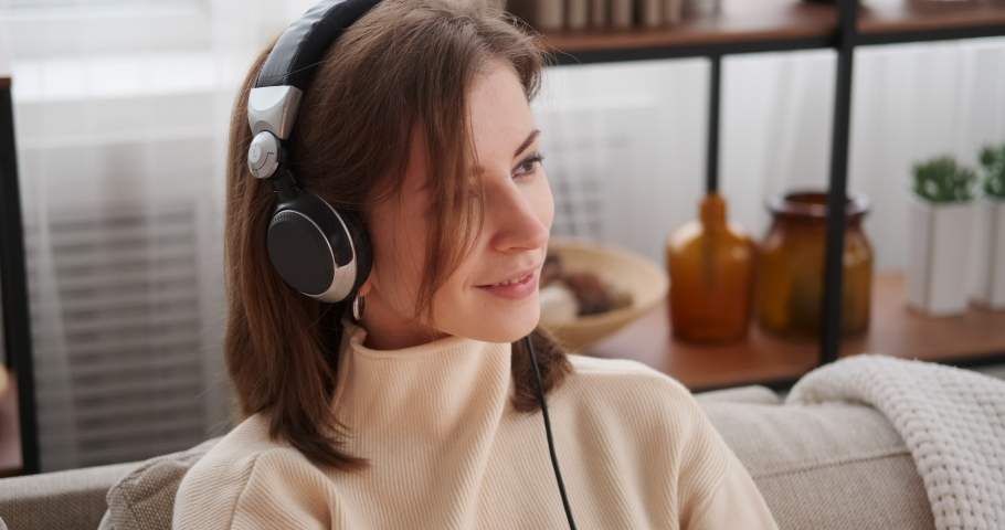 Woman listening to music on headphones | Shutterstock HD Video #1046955301
