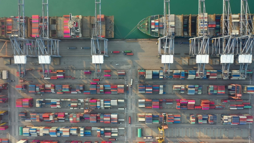 Aerial view. Container ship in pier with crane bridge carries out export and import business in the open sea. Logistics and transportation | Shutterstock HD Video #1047078631