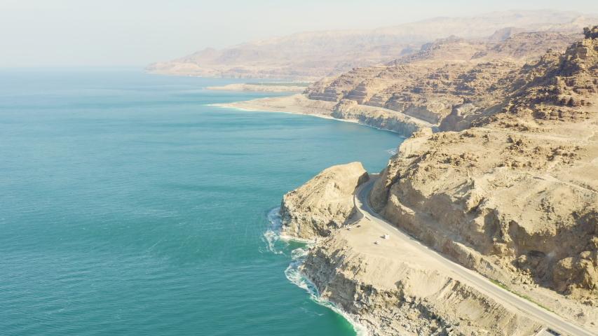 Aerial view of Dead Sea over the sea shore of Jordan,   Shutterstock HD Video #1047171781