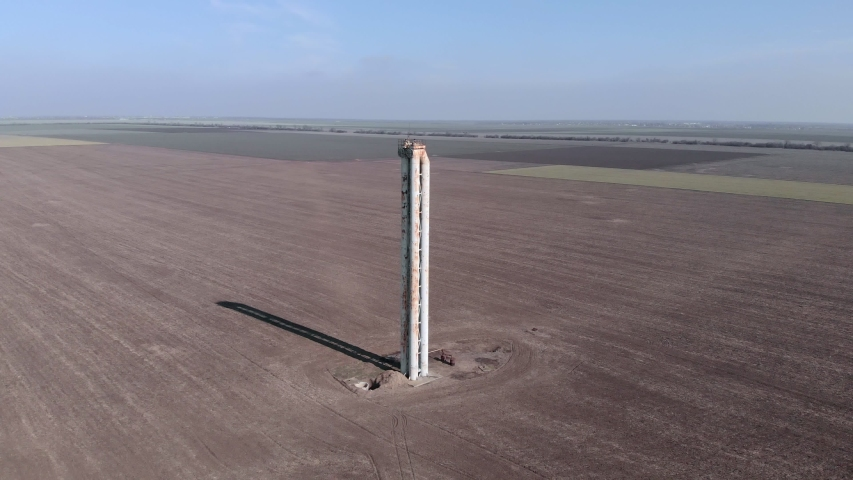 Water tower on an agricultural field. View from above | Shutterstock HD Video #1047252151